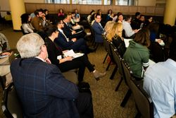 Attendees discuss challenges facing immigrant students.
