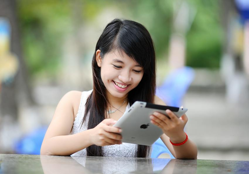 girl looking at tablet