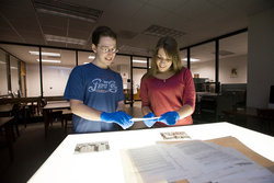 Students Andrew Weisberg and Jessica Campbell work with archival materials in Mason's Special Collections Reading Room